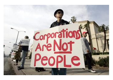 Man with corporations are not people sign