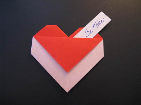 How to fold an origami heart envelope.