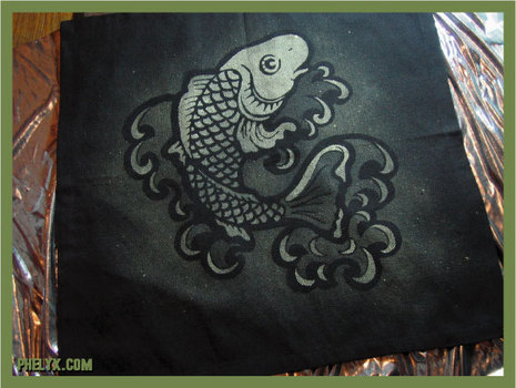 He uses stencils and bleach to achieve a tattooed effect on fabric.