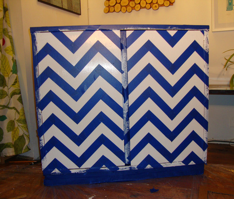 Tape in between each pencil line until the entire cabinet is a taped chevron pattern.