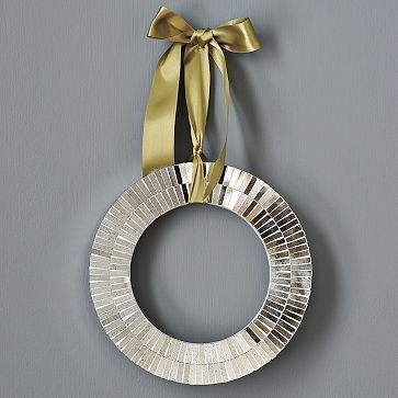 Credit: West Elm [http://www.westelm.com/products/mosaic-mirror-wreath-c069/?pkey=choliday-decor&cm_src=productsearch]