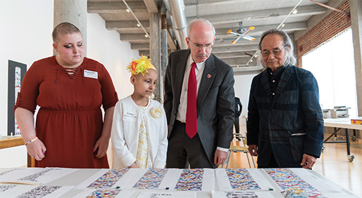At an event introducing the concept for the 80-foot sculpture at University of Nebraska Medical Center, artist JUN KANEKO, right, discusses the work with attendees. - IMAGES COURTESY OF NEBRASKA MEDICINE