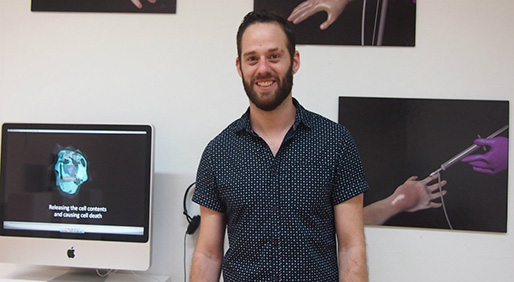 Ryan Berardi standing in front of some of his 3D animation images. - PHOTO COURTESY OF RYAN BERARDI