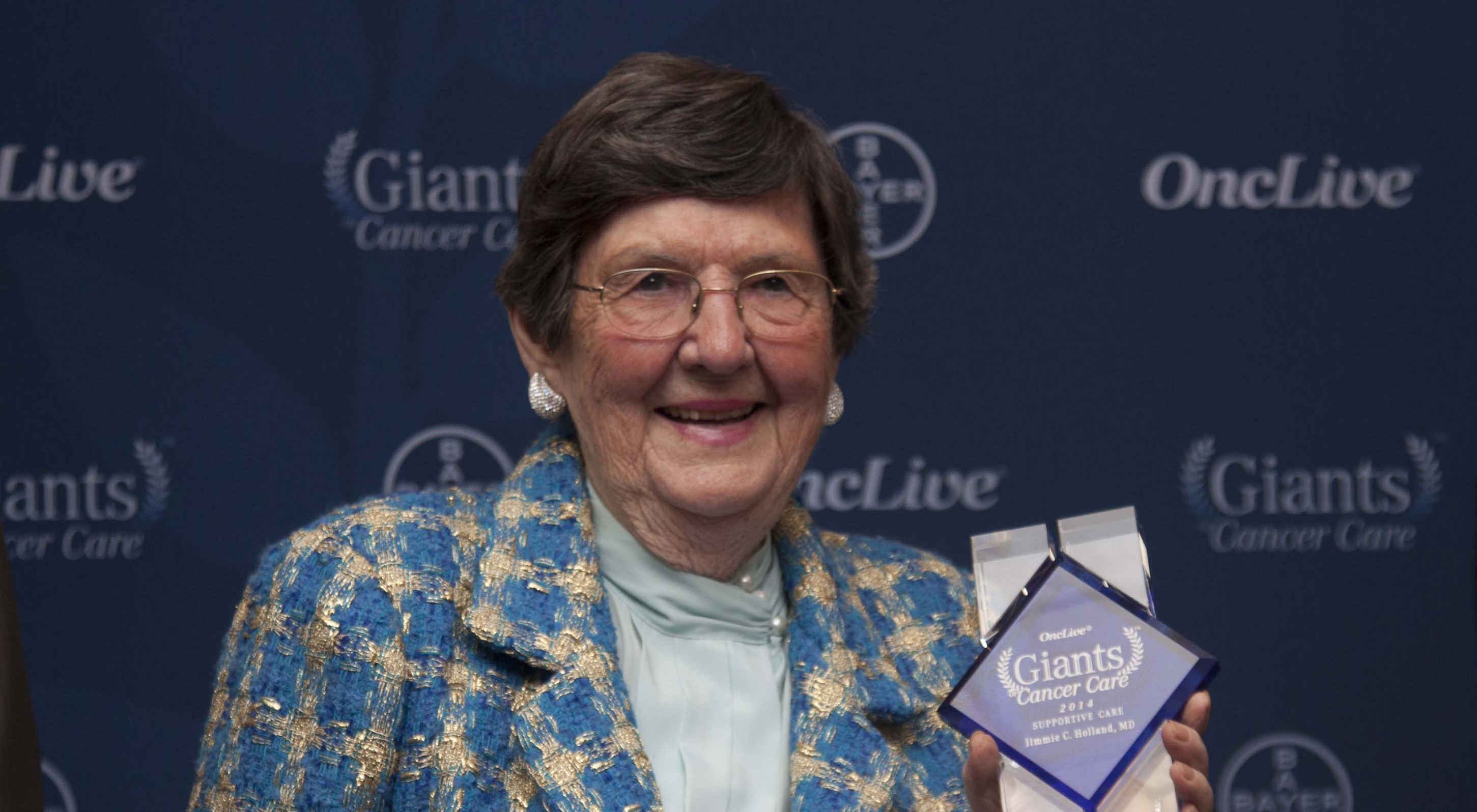 Holland receiving the Giants of Cancer Care award in 2014.