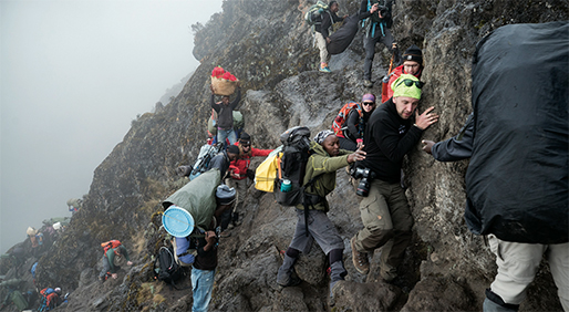 Climbers battled the changing climate and terrain of Mount Kilimanjaro with the help of local guides and porters, who helped carry equipment.- PHOTOS BY UNCAGE THE SOUL PRODUCTIONS