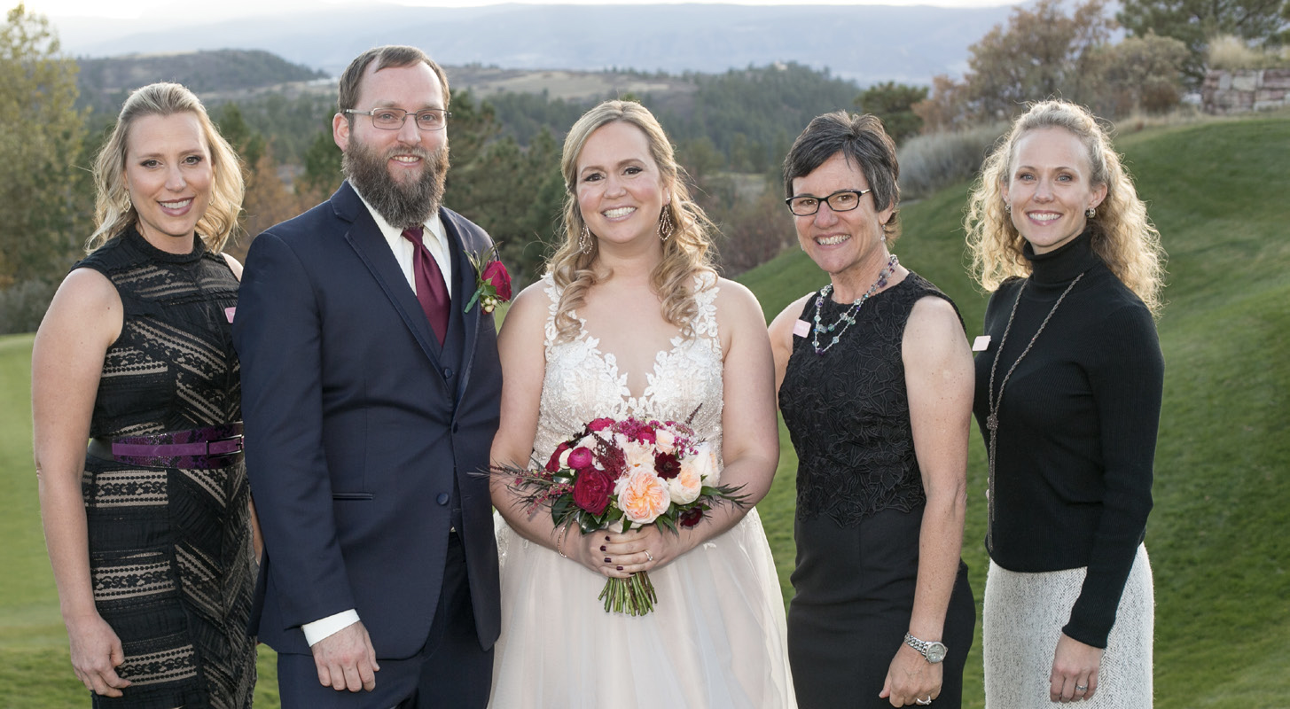 LIZ and LEE GREEN*, center, pose with, at left, 2011 Wedding Pink bride MELISSA
