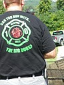 The Chief Sports The New Shirts At The Fireman's Convention T-Shirt Photo