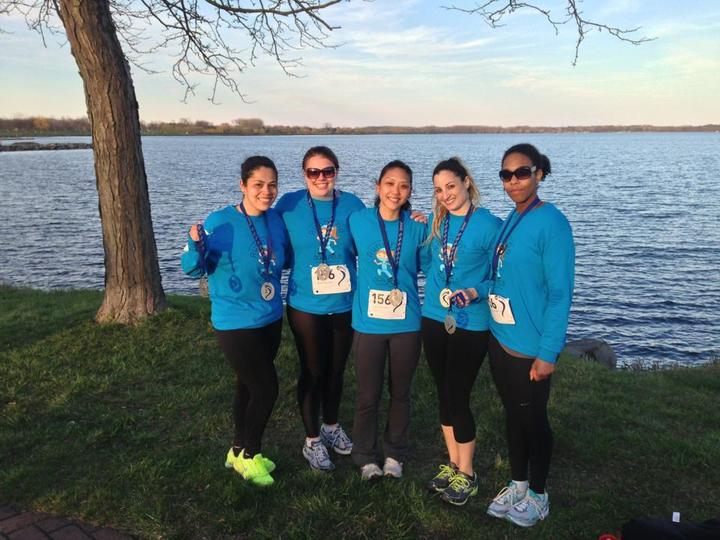 """Team """"Running With Scalpels"""" At The Finish Line Of A 78 Mile Race T-Shirt Photo"""