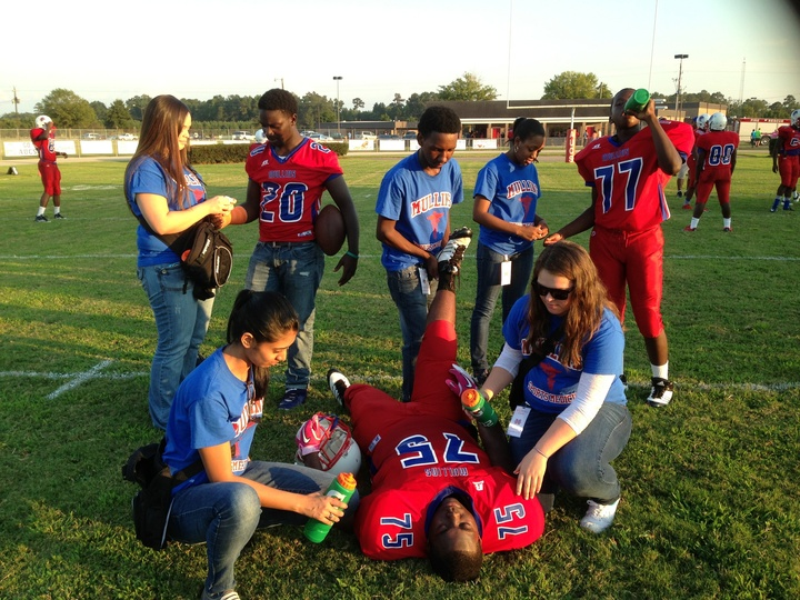 Student Athletic Training Aides Looking Great While Helping The Football Team T-Shirt Photo