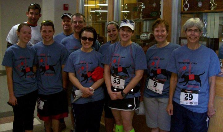 Team Snack  Run 5 Miles, Save 9 Lives T-Shirt Photo