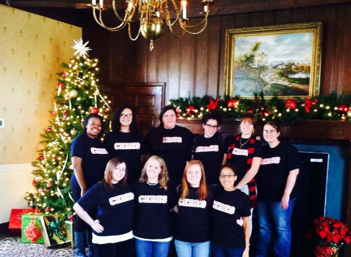 Gathered Aaround The Christmas Tree T-Shirt Photo