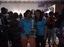 Dr. ruth n uneaq accepting trophy ttsc
