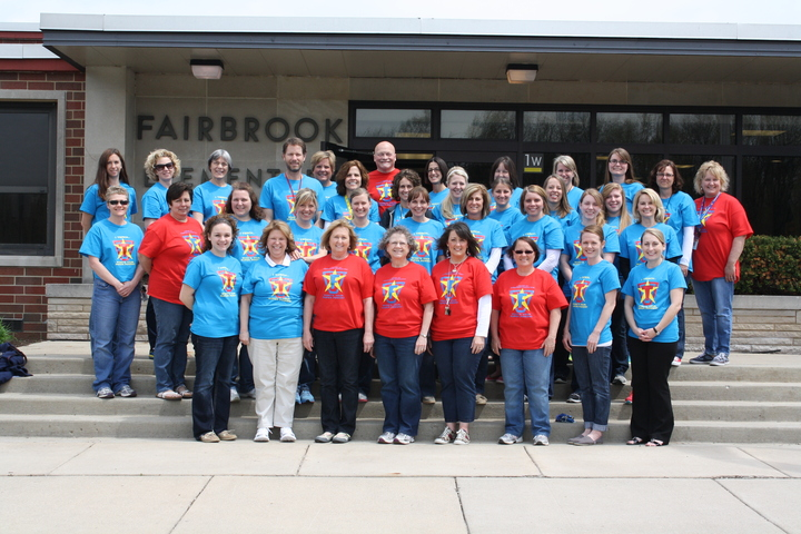 Staff Proudly Shows Off Superhero Spirit T-Shirt Photo