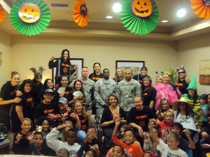 How Drs. Allen & Kelly Smudde Got Local Kids To Give Up Their Candy (And Bring Smiles To Troops Overseas!) T-Shirt Photo