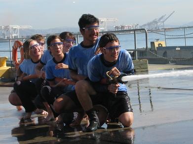 Safety At Sea Firehose Tug Of War T-Shirt Photo