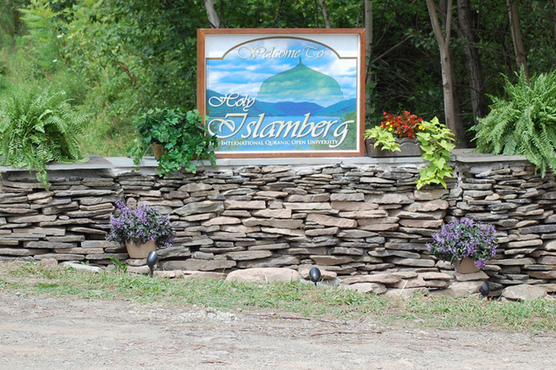 A sign welcoming visitors to holy Islamberg