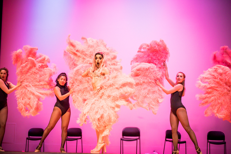 Courtney McGuire performs at the 2017 Pride Union Drag Show, surrounded by giant pink feathers.