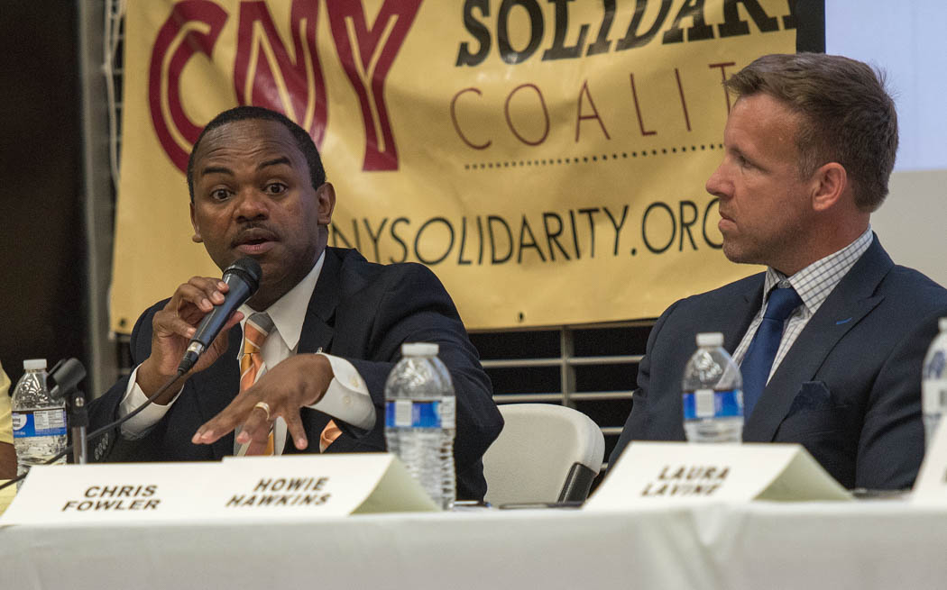 Candidate Alfonso Davis talks about establishing a citywide recreation program for youth at the Syracuse Mayoral Candidate Forum held Monday, June 19, 2017 at the Southwest Community Center in Syracuse, N.Y. Nine candidates for mayor fielded questions from moderators and the community about their positions in the race. About 200 community members packed the center to hear the six democrats, one republican, one independent and one green party candidate speak. Photo by Wasim Ahmad.
