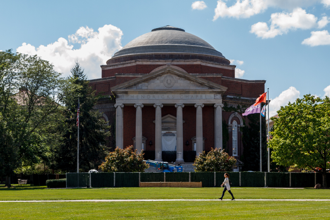 A student walks in front of Hendricks Chapel as work continues on replacing the building's steps. Work is expected to be completed the first week of October.