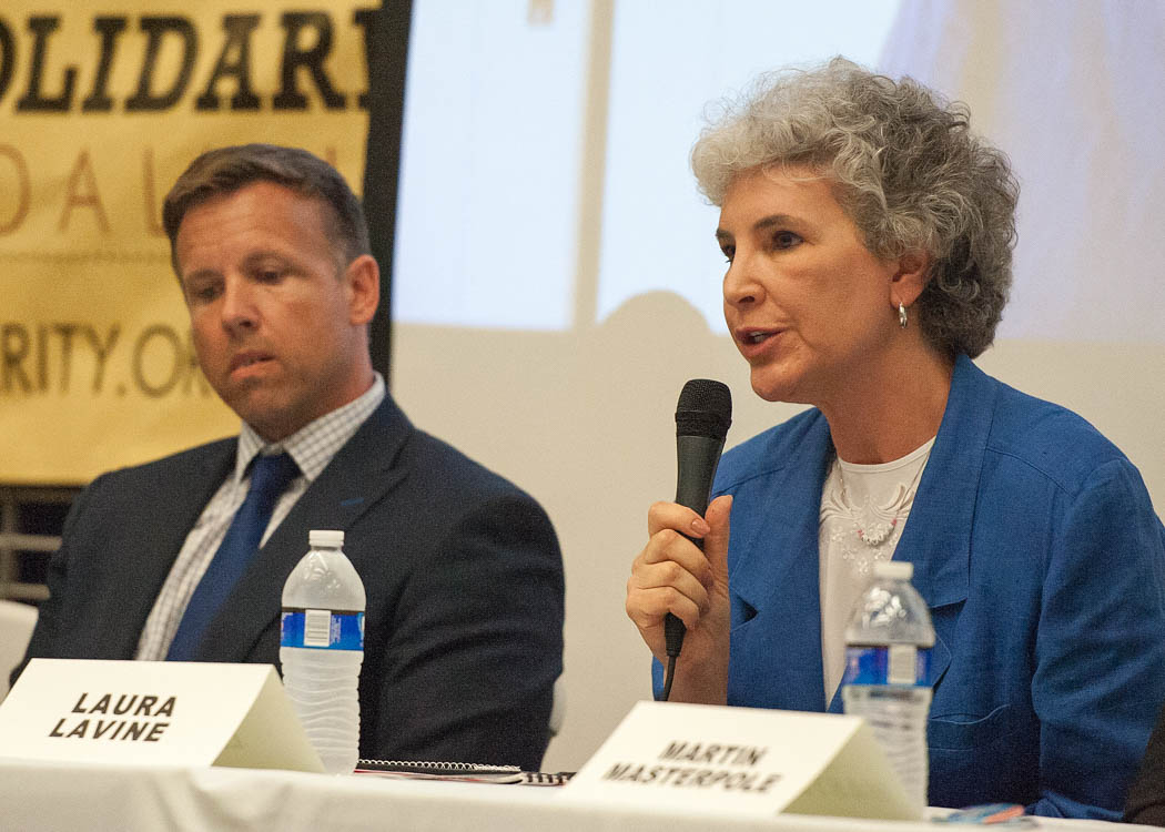 Candidate Laura Lavine answers a question at the Syracuse Mayoral Candidate Forum held Monday, June 19, 2017 at the Southwest Community Center in Syracuse, N.Y. Nine candidates for mayor fielded questions from moderators and the community about their positions in the race. About 200 community members packed the center to hear the six democrats, one republican, one independent and one green party candidate speak. Photo by Wasim Ahmad.