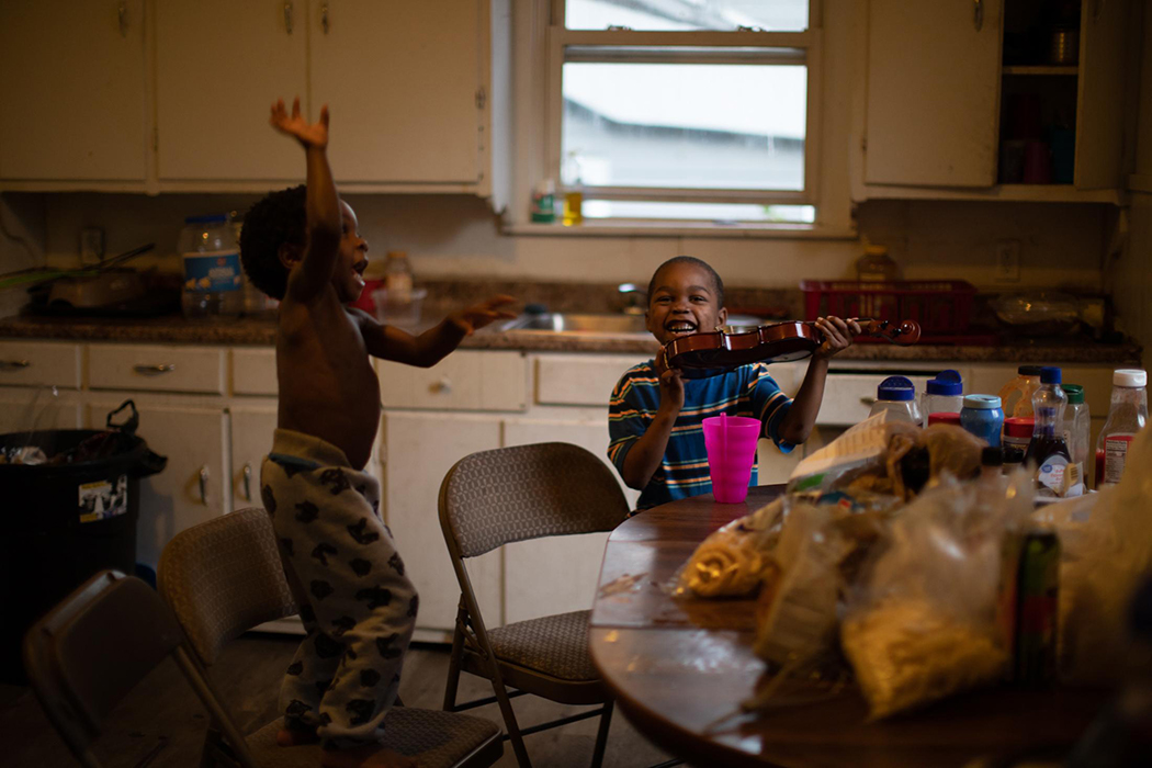 Darlene Medley's children dancing in her kitchen