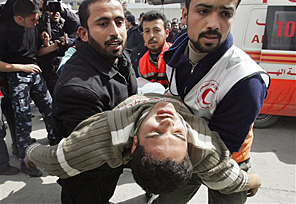 Palestinian medics carry a man wounded during an Israeli army operation in the northern Gaza Strip. Thirty-three Gazans, including at least 16 civilians, died in Israeli-Palestinian violence that escalated sharply.