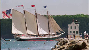 The schooner Victory Chimes  passes by the Rockland Breakwater Light off Rockland, Maine.