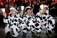 Protesters wearing cow costumes symbolizing imported U.S. beef containing mad cow disease participate in a rally against a free trade agreement with the United States in Seoul, South Korea, Monday, March 26, 2007. South Korea warned Monday a potential free trade agreement with the United States coul