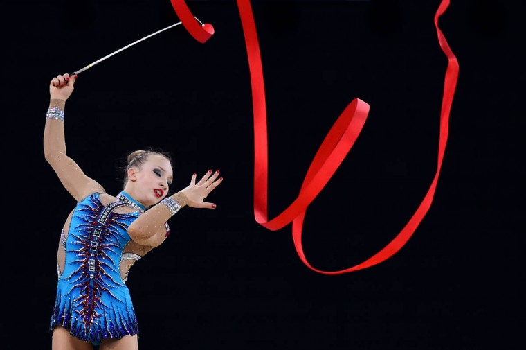 Canada's gold medalist Patricia Bezzoubenko competes in the ribbon discipline, during the Individual All-Around Final of the Rhythmic Gymnastics event at The SSE Hydro venue at the 2014 Commonwealth Games in Glasgow July 25, 2014. (Ben Stansall/Getty Images)