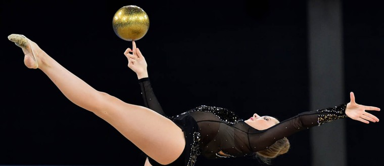 Scotland's Lauren Brash competes in the ball discipline, during the Individual All-Around Final of the Rhythmic Gymnastics event at The SSE Hydro venue at the 2014 Commonwealth Games in Glasgow July 25, 2014. (Ben Stansall/Getty Images)