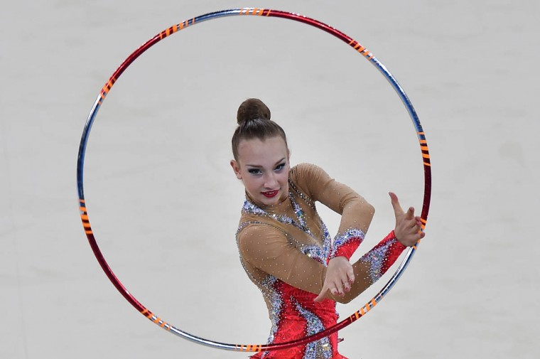 Canada's gold medalist Patricia Bezzoubenko competes in the hoop discipline, during the Individual All-Around Final of the Rhythmic Gymnastics event at The SSE Hydro venue at the 2014 Commonwealth Games in Glasgow July 25, 2014. (Ben Stansall/Getty Images)