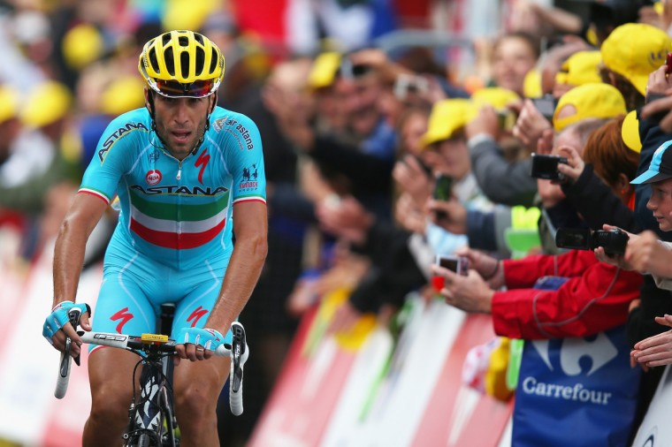 Vincenzo Nibali of Italy and the Astana Pro Team crosses the finish line to win stage ten of the 2014 Tour de France, a 162km stage between Mulhouse and La Planche des Belles Filles, on July 14, 2014 in La Planche des Belles, France. (Bryn Lennon/Getty Images)