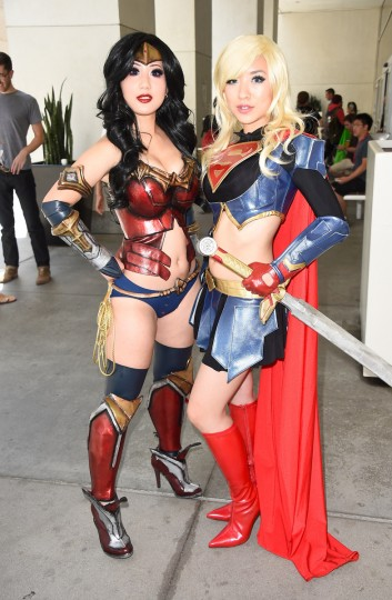 Chubear Cosplay and Stella Chu, portraying Wonder Woman and Supergirl, attend Day 3 of Comic-Con International 2014 on July 26, 2014 in San Diego, California. (Frazer Harrison/Getty Images)