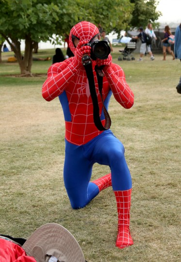 "A costumed photographer atthends ""Gotham"" Zip Line during Comic-Con International 2014 on July 26, 2014 in San Diego, California. (Mark Davis/Getty Images)"