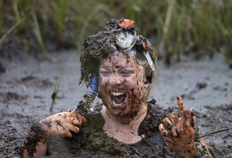 A female entrant takes a dip in the so called Bog Jacuzzi after takes part in the Irish Bog Snorkelling championship this afternoon at Peatlands Park on July 27, 2014 in Dungannon, Northern Ireland. The annual event sees male and female competitors swim the 60m length of the bog watched by scores of spectators and takes place on International Bog Day. (Charles McQuillan/Getty Images)
