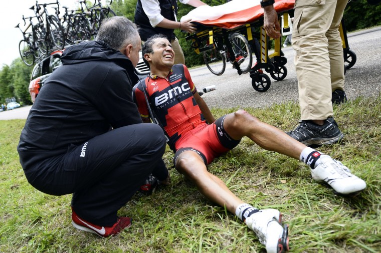 Colombia's John Darwin Atapuma receives medical assistance after a fall during the 234.5 km seventh stage of the 101st edition of the Tour de France cycling race on July 11, 2014 between Epernay and Nancy, northeastern France. (Lionel Bonaventure/Getty Images)