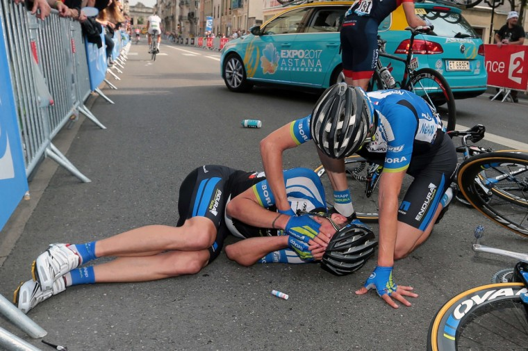 Germany's Paul Voss lies after a fall during the 234.5 km seventh stage of the 101st edition of the Tour de France cycling race on July 11, 2014 between Epernay and Nancy, northeastern France. (Fred Mons/Getty Images)
