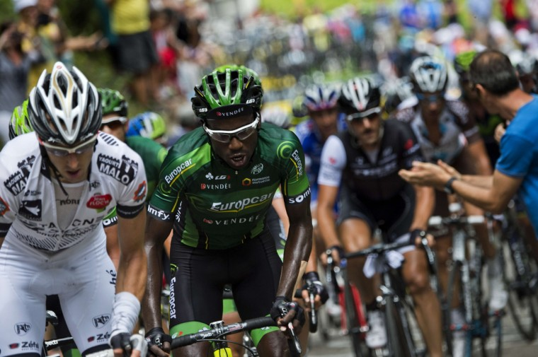 France's Kevin Reza (2ndL) rides in the pack during the 170 km ninth stage of the 101st edition of the Tour de France cycling race on July 13, 2014 between Gerardmer and Mulhouse, eastern France. (Lionel Bonaventure/Getty Images)