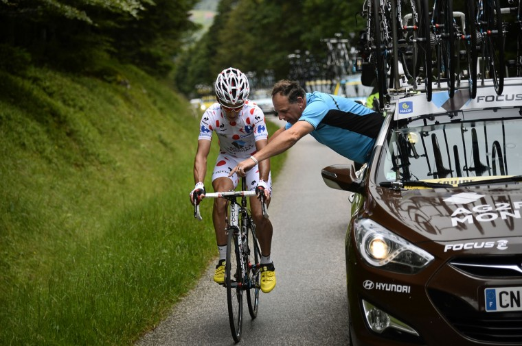 France's Blel Kadri receives assistance from the team mechanic during the 170 km ninth stage of the 101st edition of the Tour de France cycling race on July 13, 2014 between Gerardmer and Mulhouse, eastern France. (Lionel Bonaventure/Getty Images)