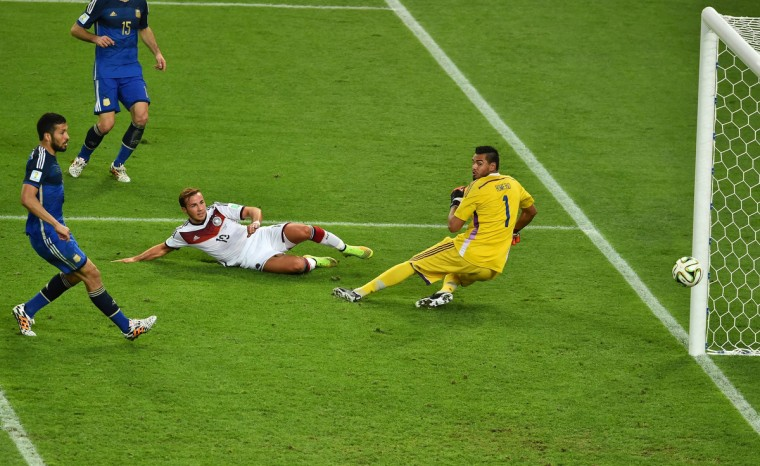 Germany's forward Mario Goetze (C) shoots and scores past Argentina's goalkeeper Sergio Romero during the 2014 FIFA World Cup final football match between Germany and Argentina at the Maracana Stadium in Rio de Janeiro on July 13, 2014. (Gabriel Bouys/Getty Images)