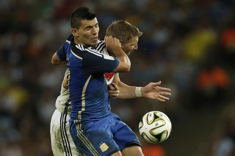 Argentina's forward Sergio Aguero and Germany's midfielder Bastian Schweinsteiger clash during extra time of the 2014 FIFA World Cup final football match between Germany and Argentina at the Maracana Stadium in Rio de Janeiro on July 13, 2014. (Adrian Dennis/Getty Images)