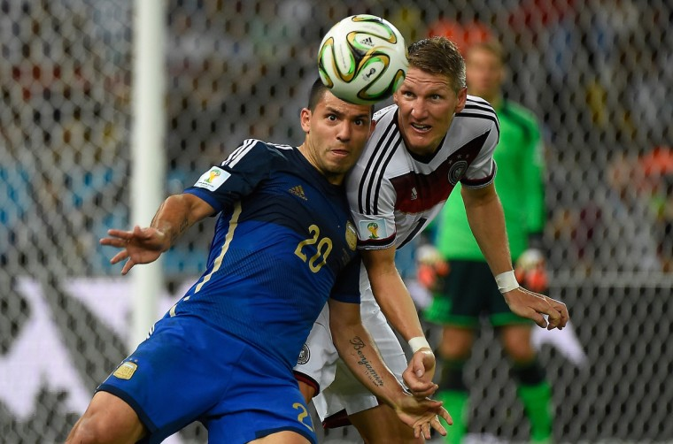 Argentina's forward Sergio Aguero (L) vies with Germany's midfielder Bastian Schweinsteiger (R) during the final football match between Germany and Argentina for the FIFA World Cup at The Maracana Stadium in Rio de Janeiro on July 13, 2014. (Odd Andersen/Getty Images)