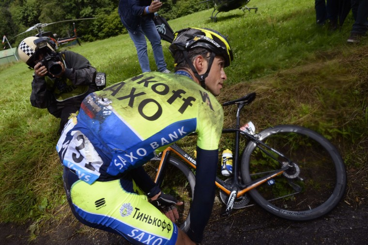 Spain's Alberto Contador is seen after a fall during the 161.50 km tenth stage of the 101st edition of the Tour de France cycling race on July 14, 2014 between Mulhouse and La Planche des Belles Filles ski resort, eastern France. (Lionel Bonaventure/Getty Images)