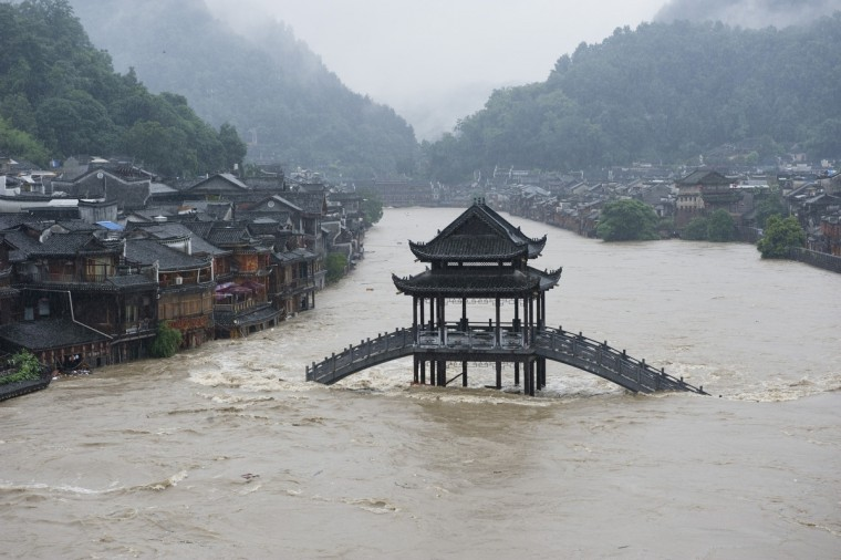 A bridge submerged in floodwaters in the ancient town of Fenghuang, central China's Hunan province. Rainstorms lashed central China's Hunan Province and southwest China's Guizhou Province, affecting over 1 million people and flooding a historical town, state media reported. (Getty Images)