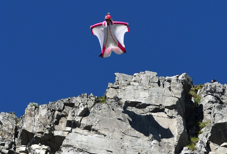 Switzerland's Geraldine Fasnacht jumps from the top of the Brevent mountain to fly in wingsuit over the French ski resort of Chamonix. (Phillippe Desmazes/Getty Images)