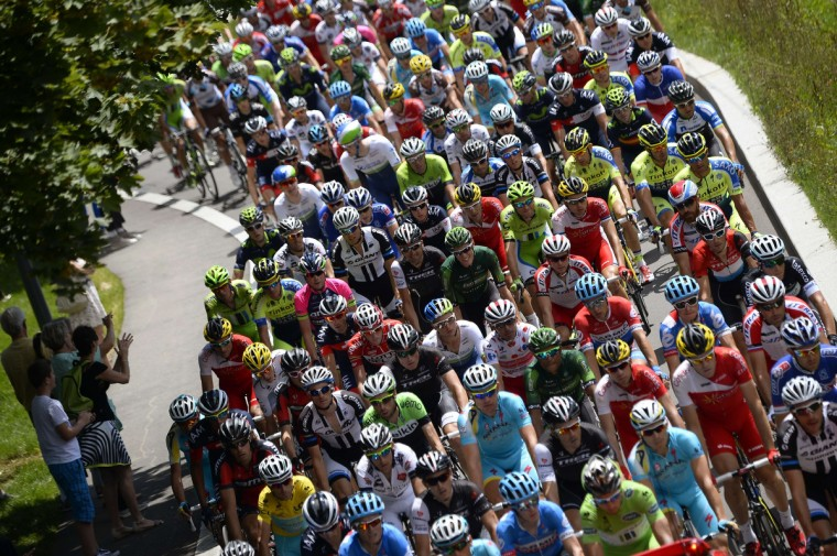 Riders take the start of the 187.5 km eleventh stage of the 101st edition of the Tour de France cycling race on July 16, 2014 between Besancon and Oyonnax, eastern France. (Lionel Bonaventure/Getty Images)