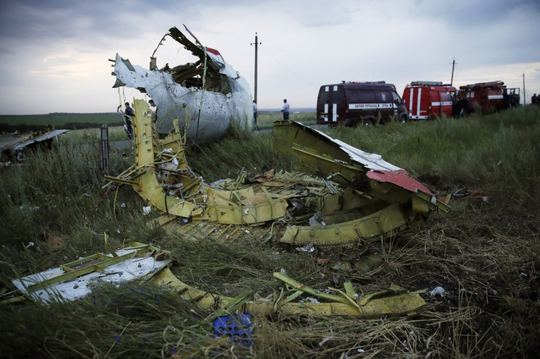 "A picture taken near the town of Shaktarsk, in rebel-held east Ukraine, on July 17, 2014 shows the wreckages of the Malaysian airliner carrying 295 people from Amsterdam to Kuala Lumpur after it crashed. Malaysia Airlines said today it had ""lost contact"" with one of its passenger planes carrying 295 people over eastern Ukraine, amid speculation it had been shot down. (Zurab Dzhavakhadze/Getty Images)"