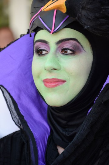 An attendee dressed as the Disney villain Maleficent attends the first day of the 45th annual San Diego Comic-Con, in San Diego California July 24, 2014. The four-day pop culture extravaganza celebrates film, TV, video games, comic books, costumes and other popular arts. More than 150,000 fans are expected to attend the sold-out event. (Robyn Beck/Getty Images)