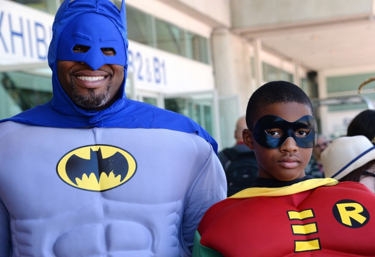 Erien Hodge and his son Adonis Hodge, 13, are dressed as Batman and Robin on the first day of the 45th annual San Diego Comic-Con, in San Diego California July 24, 2014. The four-day pop culture extravaganza celebrates film, TV, video games, comic books, costumes and other popular arts. More than 150,000 fans are expected to attend the sold-out event. (Robyn Beck/Getty Images)