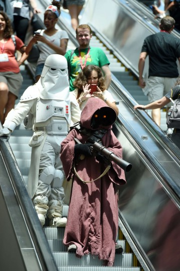 Attendees dressed as Star Wars characters ride the escalator on the third day of the 45th annual Comic-Con, in San Diego, California July 26, 2014 at the San Diego Convention Center . (Robyn Beck/Getty Images)